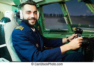 Smiling Pilot in Airplane
