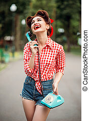 Smiling pinup girl with retro rotary phone, vintage american...