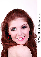 Smiling portrait young red head woman bare shoulder