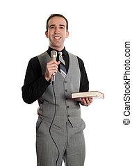 Smiling Preacher - A smiling young preacher holding a...