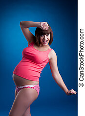 Smiling pregnant brunette young woman
