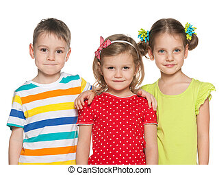 Smiling preschoolers - Three smiling preschoolers on the ...