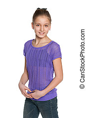 Smiling preteen girl against the white - A portrait of a...