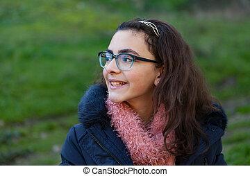 Smiling preteen girl in the garden