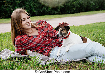 Smiling pretty 20-25 years girl with foxterrier. - Smiling...