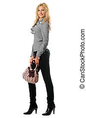 Smiling pretty blonde with a handbag
