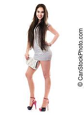 Smiling pretty brunette in gray dress