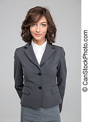 Smiling pretty business woman on white background