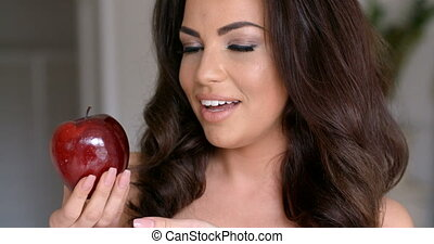 Smiling Pretty Woman Holding Fresh Red Apple