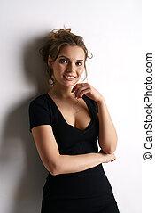 Smiling pretty woman in black skin-tight dress