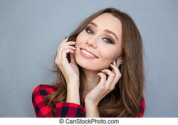 Smiling pretty woman looking at camera