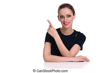 woman sits at the desk and pointing finger
