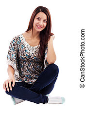 Smiling pretty woman wearing jeans sitting on floor