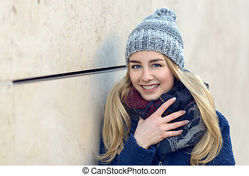 Smiling pretty young woman in a beanie