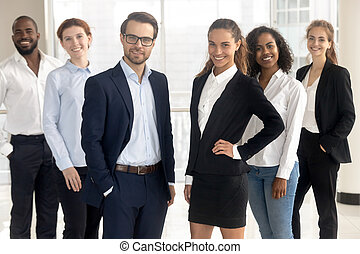 Smiling professional leaders coaches looking at camera with employees businesspeople