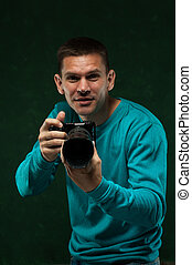 Smiling professional photographer with camera