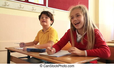 Smiling pupils working together