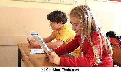 Smiling pupils working together