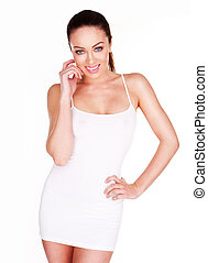 Smiling radiant beautiful natural woman in plain white summer dress, concept for vitality, health amd wellbeing.