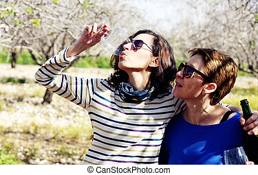 smiling real mature women celebrate birthday outdoor