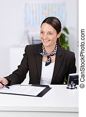 Smiling Receptionist At Counter