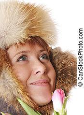 Smiling redhead in warm hood