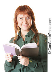 Smiling redhead with open book