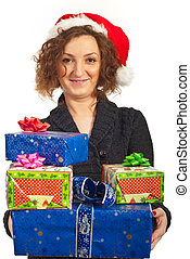 Smiling redhead woman holding Xmas gifts