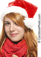 smiling redhead young woman with santas hat on white background