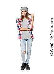 Smiling relaxed teen girl standing in full length, looking ...