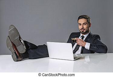 Smiling relaxing businessman having a break - Portrait of ...