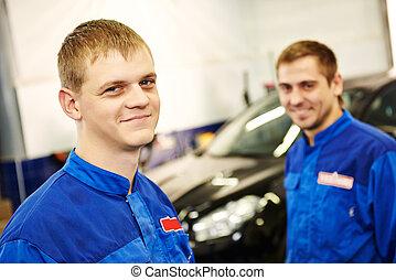 smiling repairmen auto mechanic