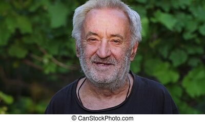 Smiling rural old man on nature