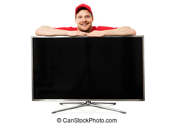 smiling salesman in red uniform over big blank tv screen isolated on white background