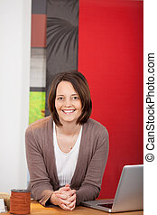 smiling saleswoman in a decorator shop - smiling saleswoman...