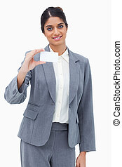 Smiling saleswoman presenting blank business card