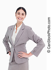 Smiling saleswoman with hands on her hip