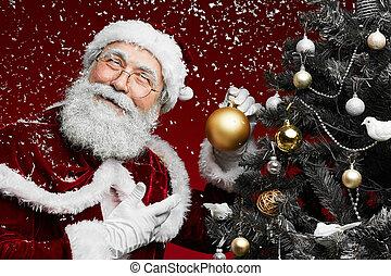 Smiling Santa Claus by Christmas Tree
