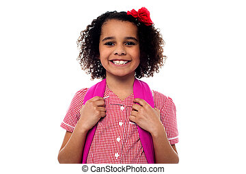 Smiling school girl with a backpack
