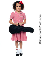 Smiling school girl with guitar