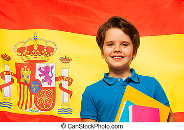Smiling schoolboy learning Spanish
