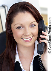 smiling secretary answering phone