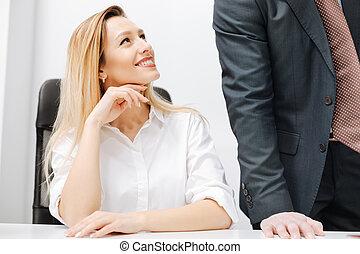 Smiling secretary flirting in the office
