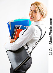 Smiling secretary - Portrait of a business woman with a pile...
