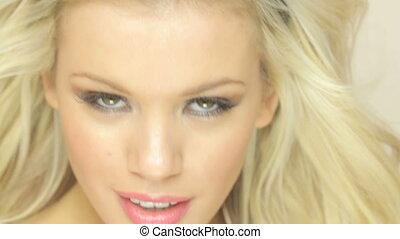 Smiling Seductive Blonde Woman