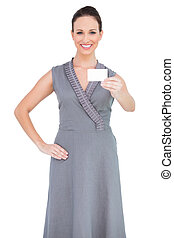 Smiling seductive woman holding business card