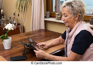 senior adult woman with tablet