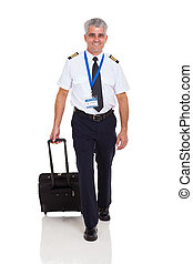 airline pilot walking with briefcase