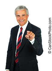Smiling Senior Businessman Pointng