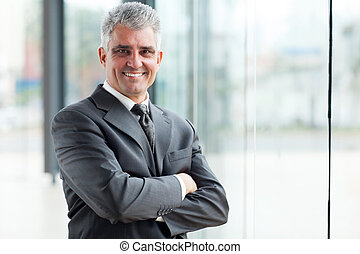 senior businessman with arms crossed - smiling senior...